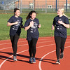 Girls on the Run in Dracut hold a practice 5K at Dracut High, to get ready for an upcoming regional 5K against other Girls on the Run groups. From left, Ella Keefe, 11, Keara Rowe, 13, and Trinity Caruso, 13, run together. (SUN/Julia Malakie)