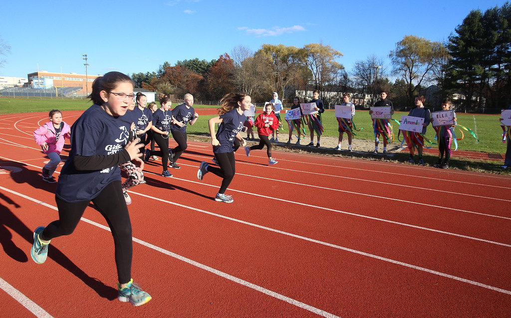 . Girls on the Run in Dracut start a practice 5K at Dracut High, to get ready for an upcoming regional 5K against other Girls on the Run groups. At left is Morgan Ruel, 12, of Dracut. (SUN/Julia Malakie)
