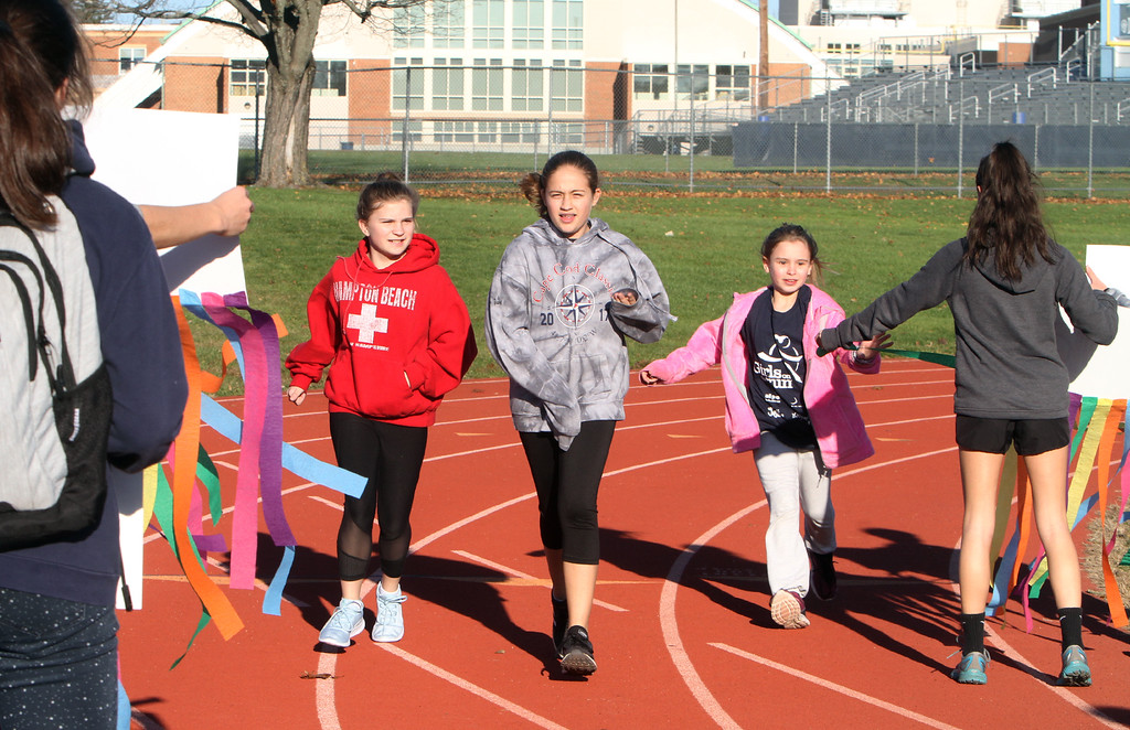 . Girls on the Run in Dracut hold a practice 5K at Dracut High, to get ready for an upcoming regional 5K against other Girls on the Run groups. Running together, from left, Elizabeth Matte, 11, Amanda Grace, 11, and Skylar Lawler, all of Dracut. (SUN/Julia Malakie)