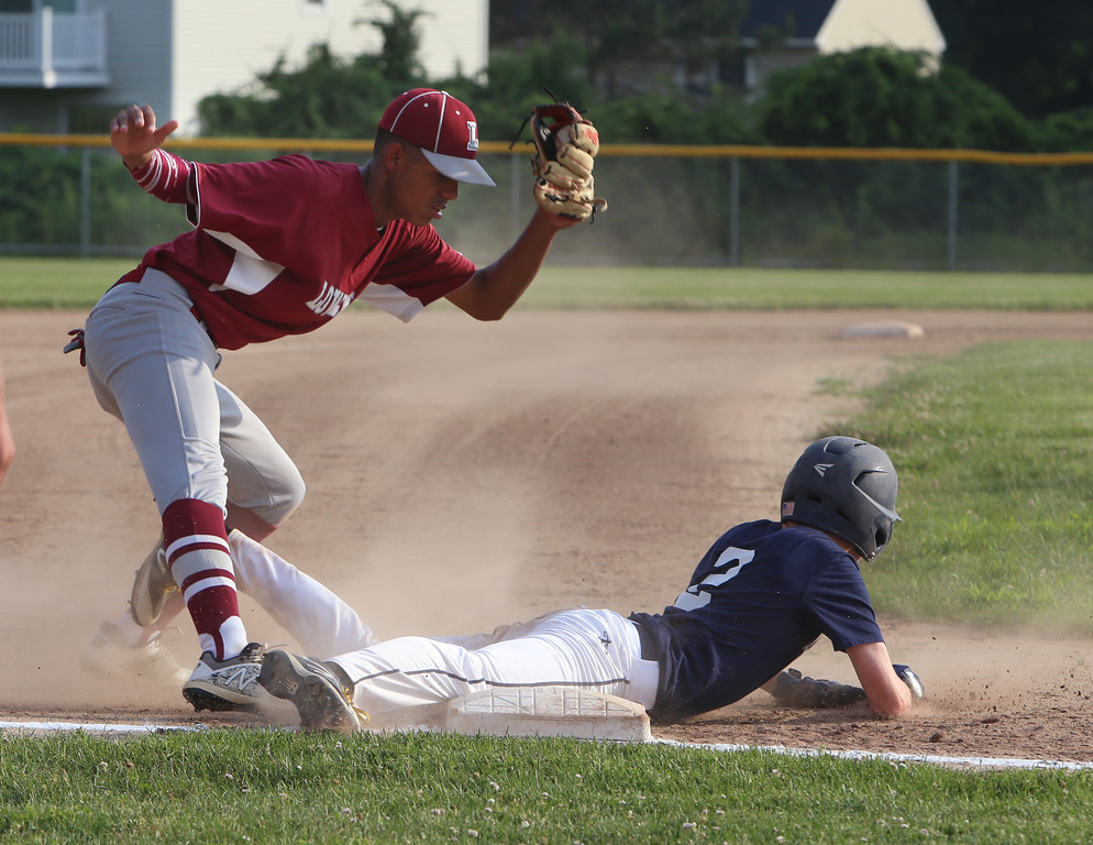 . Dracut vs Lowell Northeast Summer Baseball. Dracut baserunner Jason Tyler (2) is out at third trying to steal, with Lowell third baseman O\'Neal Jiminez making the play. (SUN/Julia Malakie)
