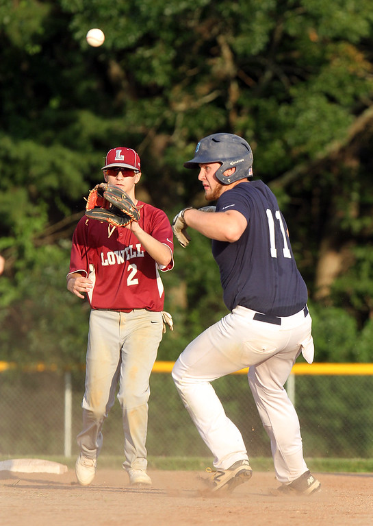 . Dracut vs Lowell Northeast Summer Baseball. Dracut\'s Gerren Kopcinski (11) is caught in a rundown between first and second before being tagged out by Lowell shortstop Matt Beland in the bottom of the fourth inning. (SUN/Julia Malakie)