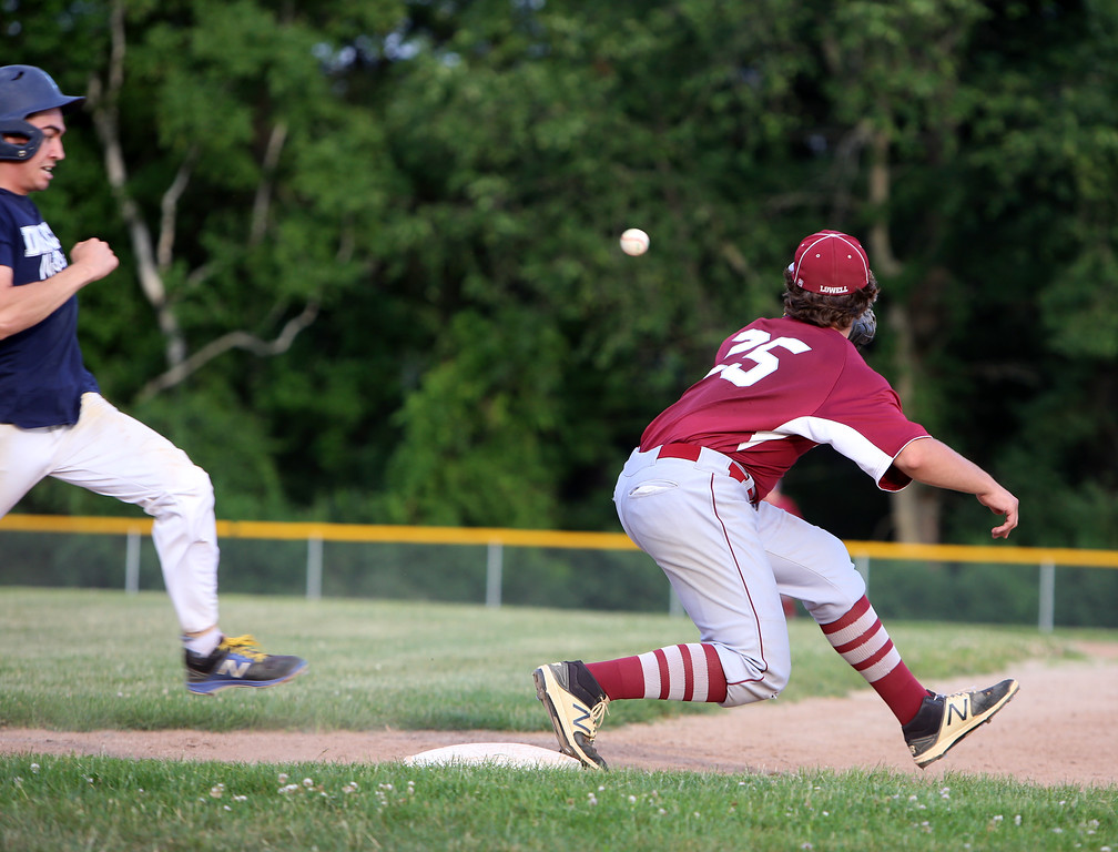 . Dracut vs Lowell Northeast Summer Baseball. Dracut\'s Pat O\'Toole (7) is safe on an infield single in the bottom of the second inning as Lowell first baseman Shawn Spring waits for the throw. (SUN/Julia Malakie)