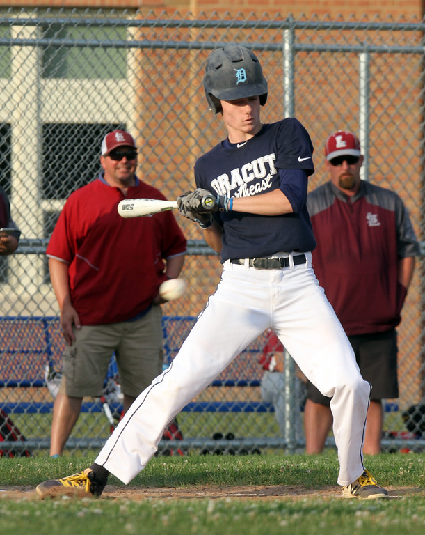 . Dracut vs Lowell Northeast Summer Baseball. Dracut\'s Jack Leahy (3) leans away from an inside pitch in th bottom of the third inning. (SUN/Julia Malakie)