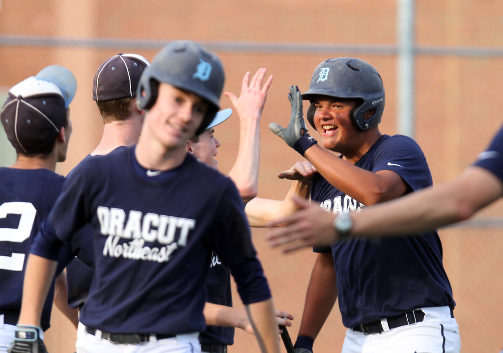 . Dracut vs Lowell Northeast Summer Baseball. Dracut\'s Jack Leahy (3), front, and Mike Moore (18), rear, score in the bottom of the second inning. (SUN/Julia Malakie)