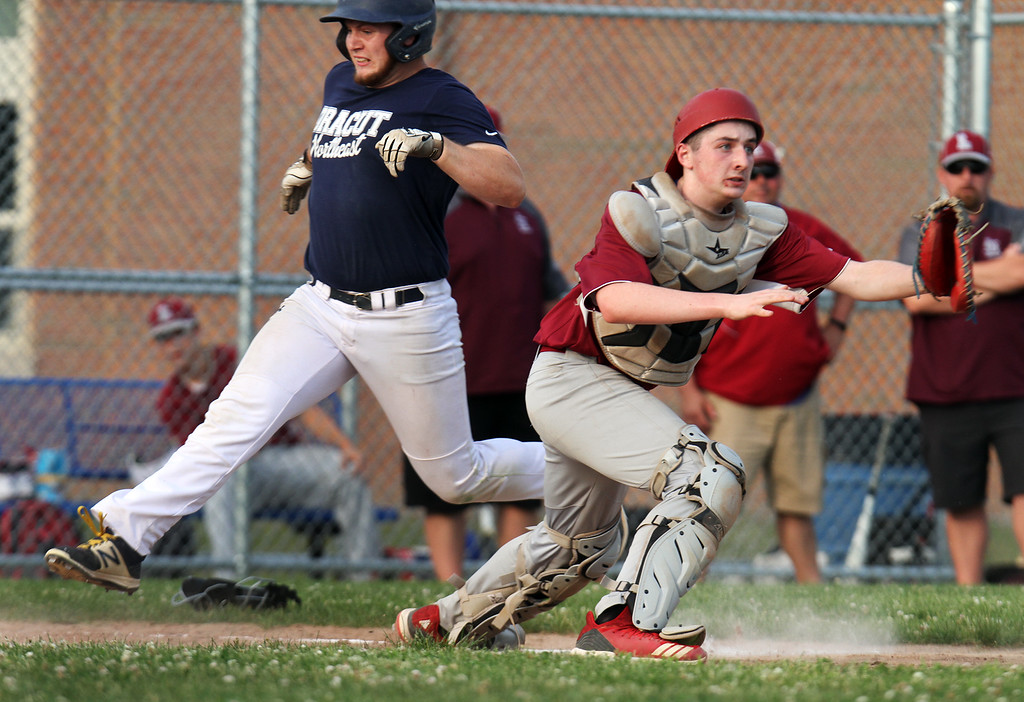 . Dracut vs Lowell Northeast Summer Baseball. Dracut\'s Gerren Kopcinski (11) scores in the bottom of the second inning as Lowell catcher [unclear if this is Nick McCabe or Joe Auger] waits for throw. (SUN/Julia Malakie)