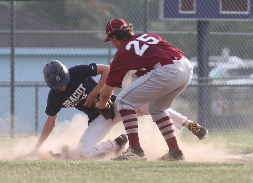 . Dracut vs Lowell Northeast Summer Baseball. Dracut\'s Pat O\'Toole (7) is tagged out by Lowell first baseman Shawn Spring after getting caught in a rundown in the bottom of the first inning. (SUN/Julia Malakie)
