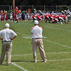 """22Aug09  studying his offense.  high school starts next weekend.  today was a scrimmage with a neighboring school.  probably the best light that I'll get shooting high school football.  <a href="""""""">one year ago.</a>  f/8, 1/800s, iso 400."""