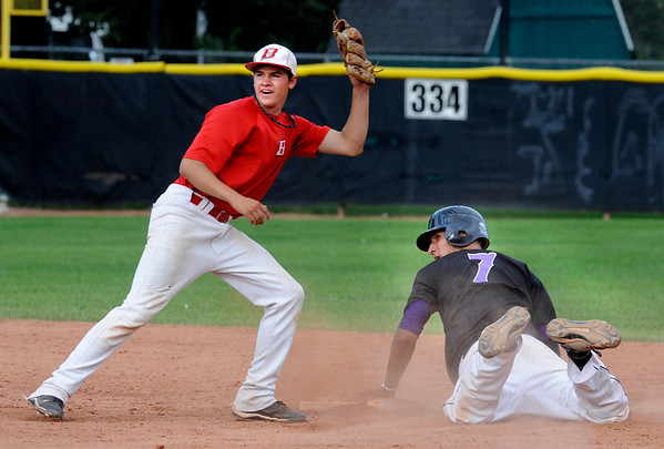 Boulder Eagles Danny Netzel is caught on a steal attempt by Brighton Bulldogs Dante Archuleta at Scott Carpenter Park on Thursday July 28, 2011<br /> Photo by Paul Aiken<br /> Boulder Eagles vs Brighton Bulldogs