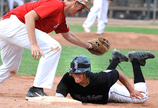 Boulder Eagles John Anagnost slides under the tag of Brighton Bulldogs Alex Werbach on a pickoff attempt at first at Scott Carpenter Park on Thursday July 28, 2011<br /> Photo by Paul Aiken<br /> Boulder Eagles vs Brighton Bulldogs