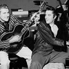 Liberace and Elvis Presley trade jackets and instruments in an impromptu jam session at the Riviera and Casino, on November 14, 1956.