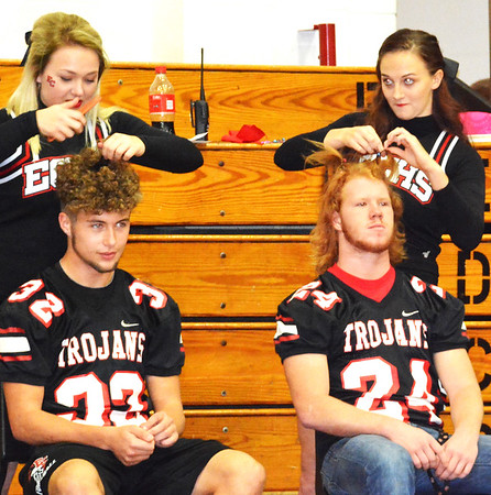 Debbie Blank | The Herald-Tribune<br /> Female students style male students' hair.