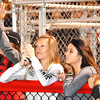 Debbie Blank | The Herald-Tribune<br /> Lots of red and black attire at Trojan Field Friday night.