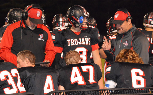 Debbie Blank | The Herald-Tribune<br /> Coaches converse with players during the first half.