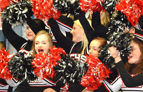 Debbie Blank | The Herald-Tribune<br /> The cheerleaders moved around the gym, perfoming gymnastics routines and chants.