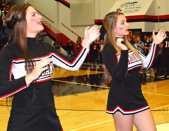 Debbie Blank | The Herald-Tribune<br /> Routines by cheerleaders help to keep spirits high.