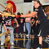 Debbie Blank | The Herald-Tribune<br /> Competitors try to flip balls into cup using brooms.