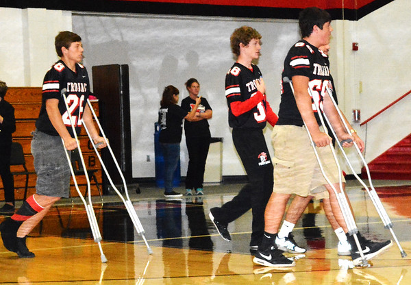Debbie Blank | The Herald-Tribune<br /> The pep rally began with football players, including the injured ones, congregating at the gym floor's center.