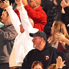 Debbie Blank | The Herald-Tribune<br /> A fan raises his arms in triumph when the Trojans go ahead for the first time 21-14 in the second quarter.