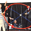 Debbie Blank | The Herald-Tribune<br /> A giant slingshot was used to catapult T-shirts into the crowd.