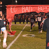Debbie Blank | The Herald-Tribune<br /> The Trojans burst through the sign, signalling the game is just minutes away.