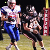 Debbie Blank | The Herald-Tribune<br /> Senior Clint Mirus keeps active in the second quarter.
