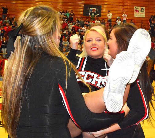Debbie Blank | The Herald-Tribune<br /> A cheerleader is successfully caught by the rest of her squad.
