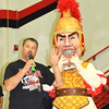 Debbie Blank | The Herald-Tribune<br /> With the help of Mr. Trojan, football coach Justin Roden thanks the students, staff and community for their great support during this football season.