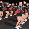 Debbie Blank | The Herald-Tribune<br /> The cheerleaders did high kicks and even pushups to keep the crowd enthused.