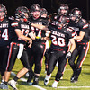 Debbie Blank | The Herald-Tribune<br /> The East Central High School Trojans celebrate their first touchdown at 2:25 in the first quarter.