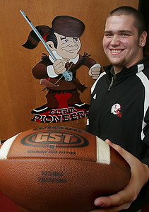 """3FEB10  Isaiah Byler, 18, a senior at Elyria High School, signed to play football with Bowling Green State University.  """"I have a great opportunity in front of me.  I can't wait to step up to the challenge,"""" said Byler.  photo by Chuck Humel"""