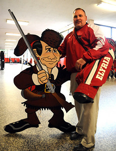Elyria High principal Darren Conley holds Petey Pioneer from the old EHS gym ,and an EHS golf bag, which will be among the EHS memorabilia to be sold on Saturday.   Steve Manheim