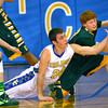 2-28-14   --- EHS vs Tri-C HS Boys Basketball. In the 3rd quarter action Tri-Central's Seth Blunck and Eastern's Blake Shrader scramble for a loose ball that eastern originally was steeling from TriC. -- <br />   KT photo | Tim Bath