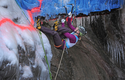 """Emily Harrington of Boulder, Colorado makes her way onto the manmade portion of the climb where climbers had to cross from one side of the canyon to the other.  She placed first among the women competitors. The 17th annual Ouray Ice festival hosted 18 elite climbers from all over the nation, Canada and France.  Three women and 15 men competed for a first place purse of $2000 for each the men's and the women's finishers.  The centerpiece for the mixed climbing event was a unique narrow manmade loaf of ice that crossed from one side of the gorge to the other while dangling 50 feet off the canyon floor. The overhanging loaf of ice, which the creators of the route called """"Povitica"""" proved to be the crux or the hardest part of the climb.  Povitica is Slovenian for sweet nut loaf.  Climbers competed against one another but also against the clock.  They had only 15 minutes to finish the route.  Only two climbers successfully completed the M10 rated route. Helen H. Richardson, The Denver Post"""