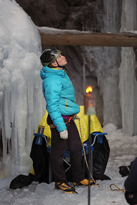 """Emliy Harrington of Boulder, Colorado, studies the route before making her ascent.  She finished first among the women competitors.  She did not finish the route but was the one that got the highest on the route before coming off. The 17th annual Ouray Ice festival hosted 18 elite climbers from all over the nation, Canada and France.  Three women and 15 men competed for a first place purse of $2000 for each the men's and the women's finishers.  The centerpiece for the mixed climbing event was a unique narrow manmade loaf of ice that crossed from one side of the gorge to the other while dangling 50 feet off the canyon floor. The overhanging loaf of ice, which the creators of the route called """"Povitica"""" proved to be the crux or the hardest part of the climb.  Povitica is Slovenian for sweet nut loaf.  Climbers competed against one another but also against the clock.  They had only 15 minutes to finish the route.  Only two climbers successfully completed the M10 rated route. Helen H. Richardson, The Denver Post"""