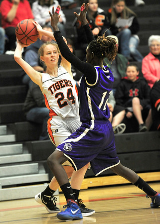 Erie High School's Hannah Gallagher (24) is defended by  Denver South's Biag Mayek (12) during their game at Erie High School on Wednesday February 22, 2012. <br /> Photo by Paul Aiken / The Camera / Boulder