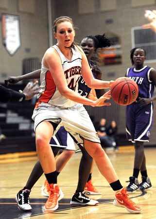 Erie High School's Holly Hatfield (44) passes the ball under the hoop against Denver South during their game at Erie High School on Wednesday February 22, 2012. <br /> Photo by Paul Aiken / The Camera / Boulder