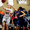 Erie High School's Nicole Hulet (42) goes up for a shot against  Denver South's Courtney Kindell (23) during their game at Erie High School on Wednesday February 22, 2012. <br /> Photo by Paul Aiken / The Camera / Boulder