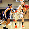 Erie High School's Amanda Ochoa (10) dribbles against Denver South's Courtney Kindell (23) during their game at Erie High School on Wednesday February 22, 2012. <br /> Photo by Paul Aiken / The Camera / Boulder