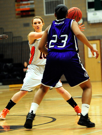 Erie High School's Amanda Ochoa (10) tries to pass around  Denver South's Courtney Kindell (23) during their game at Erie High School on Wednesday February 22, 2012. <br /> Photo by Paul Aiken / The Camera / Boulder