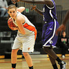 Erie High School's Holly Hatfield  (44) tries to keep the ball away from  Denver South's Nyachiang Bile (5) during their game at Erie High School on Wednesday February 22, 2012. <br /> Photo by Paul Aiken / The Camera / Boulder
