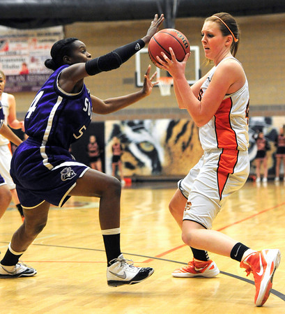 Erie High School's Holly Hatfield (44) tries to work around  Denver South's Kendra Martin (54)during their game at Erie High School on Wednesday February 22, 2012. <br /> Photo by Paul Aiken / The Camera / Boulder
