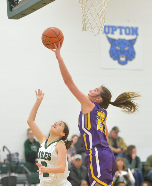 Justin Sheely | The Sheridan Press<br /> A shot by Tongue River's Nikki Perfetti is blocked the Lady Hornets's Kammie Ragsdale at Tongue River High School in Dayton Thursday, Jan. 4, 2018. The Lady Eagles lost to Pine Bluffs 59-32.