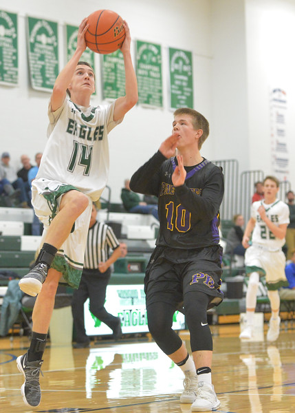 Justin Sheely | The Sheridan Press<br /> Tongue River's Nick Summers does a layup over Pine Bluffs' Andrew Fornstrom at Tongue River High School in Dayton Thursday, Jan. 4, 2018.