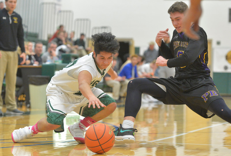 Justin Sheely | The Sheridan Press<br /> Tongue River's Elias Dillon-Bennett tries to recover possession over Hornets' Haize Forstrom at Tongue River High School in Dayton Thursday, Jan. 4, 2018.