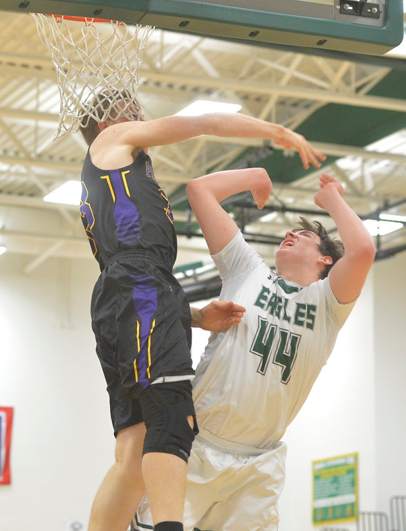 Justin Sheely | The Sheridan Press<br /> Tongue River's Hugh Patterson is fouled by Hornets' Tucker Norman at Tongue River High School in Dayton Thursday, Jan. 4, 2018.