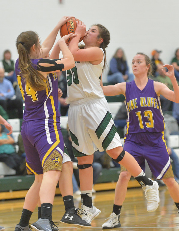 Justin Sheely | The Sheridan Press<br /> Tongue River's Zaveah Kobza is fouled by Lady Hornets' Dylan Sweeter at Tongue River High School in Dayton Thursday, Jan. 4, 2018. The Lady Eagles lost to Pine Bluffs 59-32.
