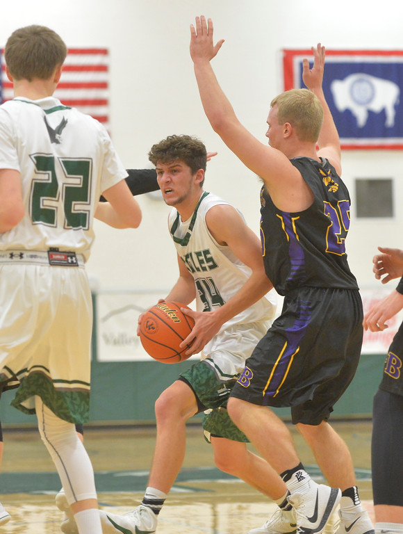 Justin Sheely | The Sheridan Press<br /> Tongue River's Jaren Fritz drives against the Hornets at Tongue River High School in Dayton Thursday, Jan. 4, 2018.