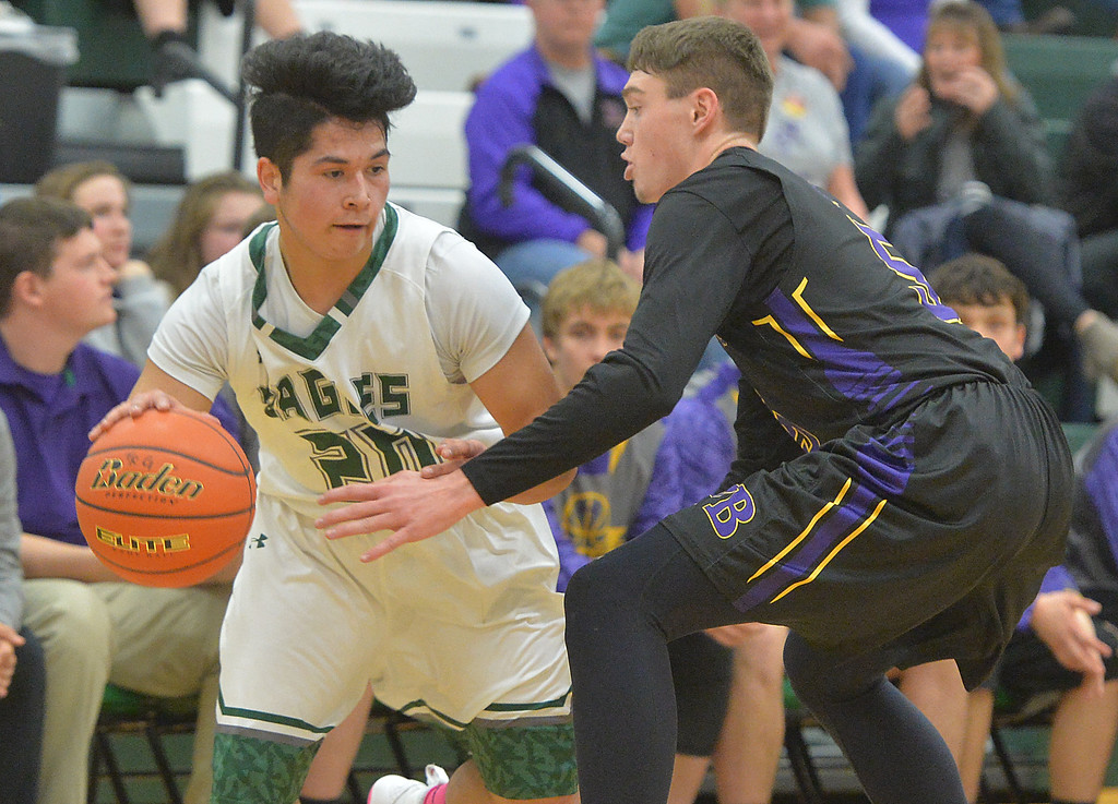 Justin Sheely | The Sheridan Press<br /> Tongue River's Elias Dillon-Bennett is guarded by Pine Bluffs' Haize Fornstrom at Tongue River High School in Dayton Thursday, Jan. 4, 2018.