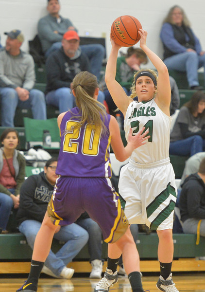 Justin Sheely | The Sheridan Press<br /> Tongue River's Brittany Fillingham looks for a pass against the Lady Hornets at Tongue River High School in Dayton Thursday, Jan. 4, 2018. The Lady Eagles lost to Pine Bluffs 59-32.