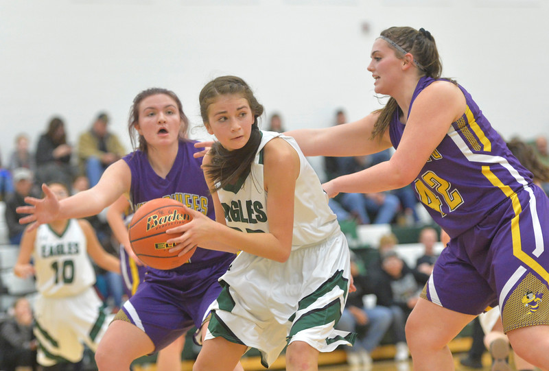 Justin Sheely | The Sheridan Press<br /> Tongue River's Holly Hutchinson looks for a pass against the Lady Hornets at Tongue River High School in Dayton Thursday, Jan. 4, 2018. The Lady Eagles lost to Pine Bluffs 59-32.